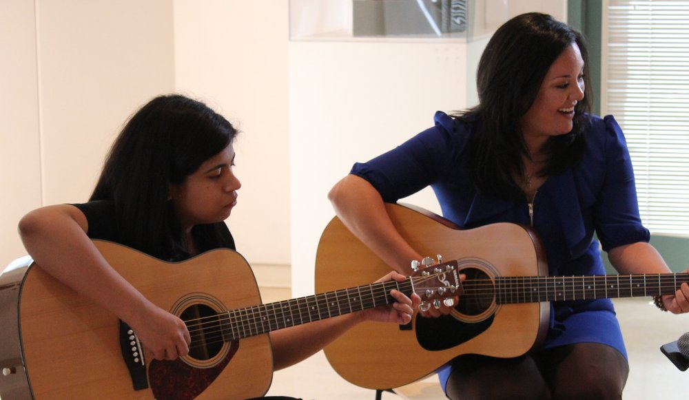 Guitar Student and Guitar Teacher